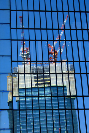 kita: Under construction building that is reflected in the window glass