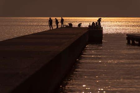 hojo: People who enjoy fishing at sunset lit levees