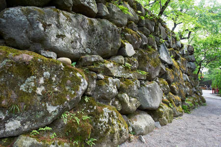 yearning: Old stone wall toward the black Monzeki