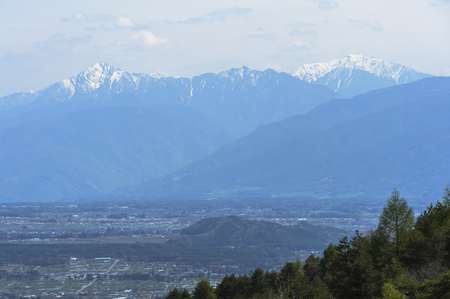 lingering: Brave figure snow is beautiful Southern Alps on the Chino
