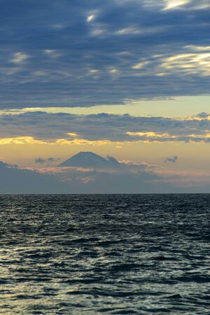 rippling: Rippling of the sunset glow to show the majestic figure on top of the sea Fuji Stock Photo