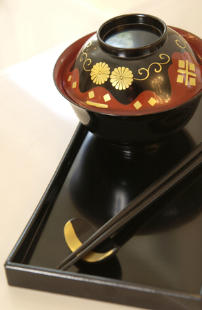 lacquered: Bowl and chopsticks Stock Photo