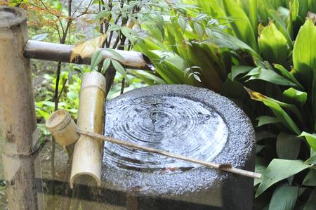 lavamanos: Piedra Chozu Foto de archivo