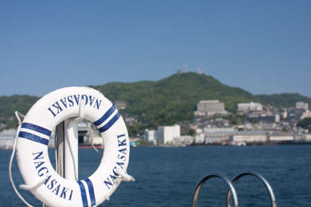 life preserver: Nagasaki harbor and life preserver Stock Photo
