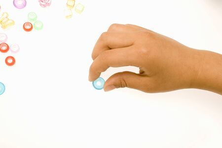 pinch: The hands of children that pinch the beads Stock Photo