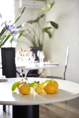 bitter orange: Bitter summer orange on the table and yellow kumquat