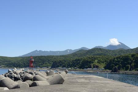 woo: Utoro View from the harbor Shiretoko mountain range Stock Photo