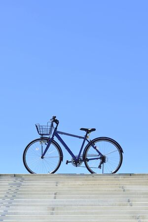 pleasent: Blue sky and the blue bicycle Stock Photo