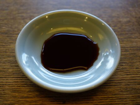 soy sauce: Small dish of soy sauce Stock Photo