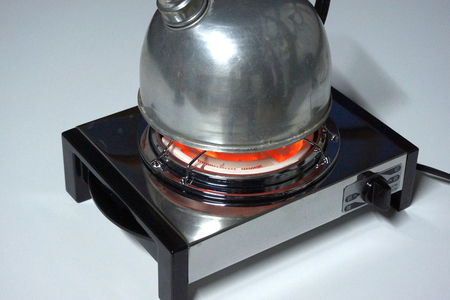 boil water: Boil water in a nostalgic electric stove