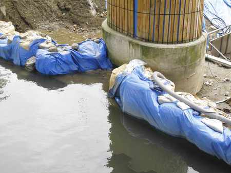 impervious: Concrete pillar construction and impervious sandbags river