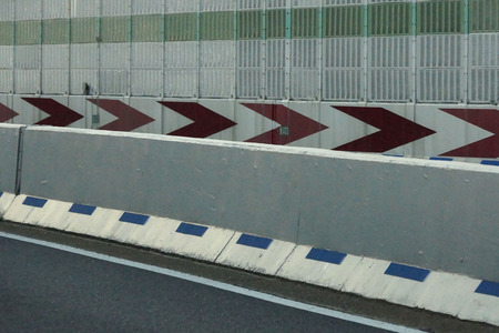 sharp curve: Center separation wall and soundproof wall of the Hanshin Expressway Stock Photo