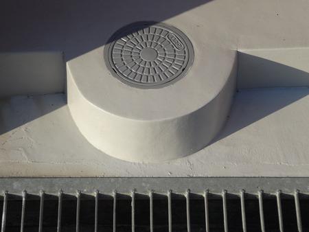 manhole: Sewage manhole housing Stock Photo