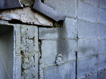damaged: The damaged concrete block Stock Photo