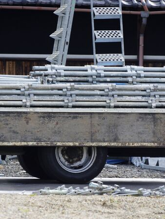 residential construction: Truck loaded with scaffolding in residential construction site