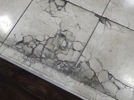 sprung: Floor of cracked tile P