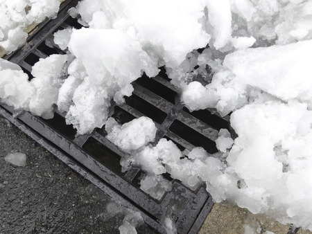 snowfalls: The snow that had piled up on the drain outlet of the sidewalk
