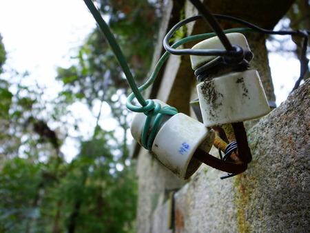 insulator: Old insulator of the wire Stock Photo