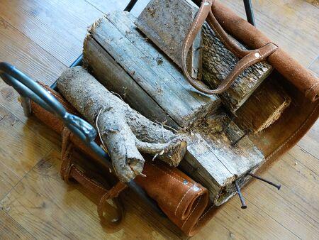 woodburning: Log tool of wood-burning stove
