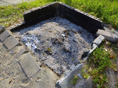 incinerator: Open-air incinerator and concrete block Stock Photo