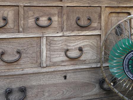 retro: Showa of paulownia chest of drawers and fan Stock Photo