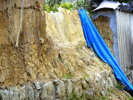 collapsed: Collapsed earthen wall