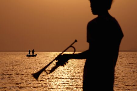 10s: Silhouette with a trumpet Stock Photo