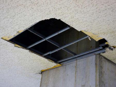 ceiling plate: torn ceiling board