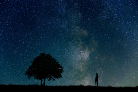 Grassland and the starry sky and the trees and women