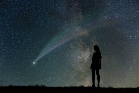 comet: Grassland and comet and women Stock Photo