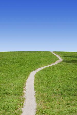 grasslands: Grasslands road and blue sky Stock Photo