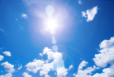 ultraviolet: Blue Sky with clouds and Sun Stock Photo