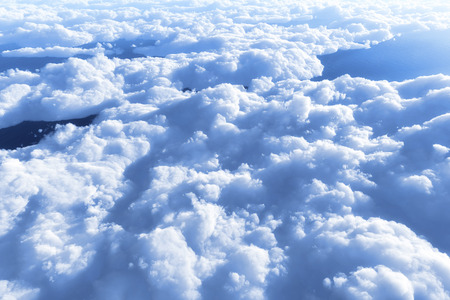 mostly: Blue sky and clouds