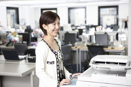 copy machine: Women who use the copy machine Stock Photo