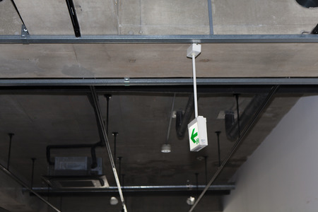 emergency light: Emergency light of vacant store before construction Stock Photo