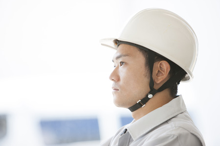 margin of safety: male workers to think Stock Photo