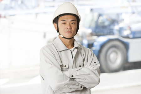 fold ones arms: Male workers to his arms folded