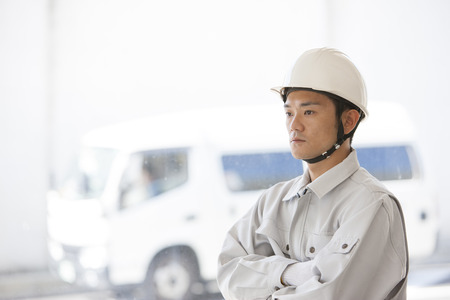 margin of safety: Male workers to his arms folded