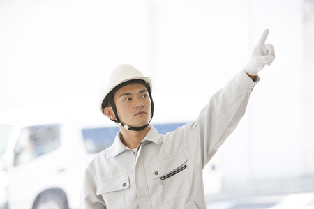 refers: Male workers refers to the finger Stock Photo