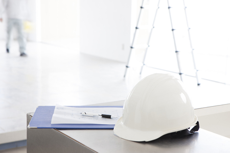 building safety: Drawing and helmet Stock Photo