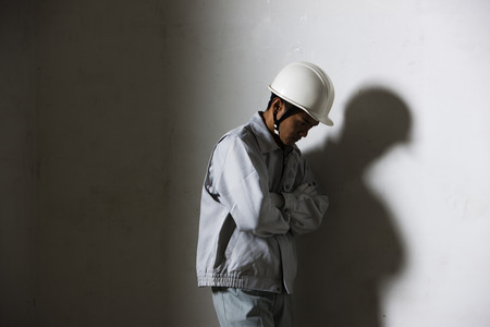 hardships: Male workers are thoughtfully