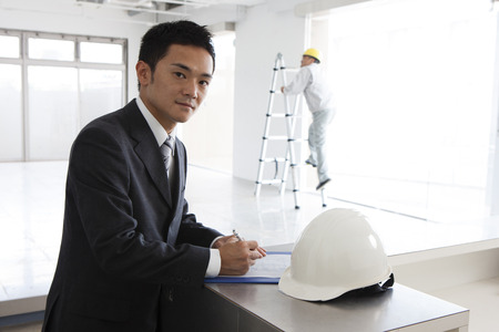 supervisor: Site supervisor to check the drawings Stock Photo