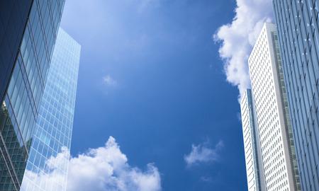 青い空と事務所ビル 写真素材