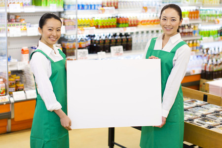 shopping buddies: Clerk of super with a white board Stock Photo