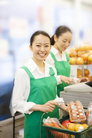 clerks: Women clerks stand cashier