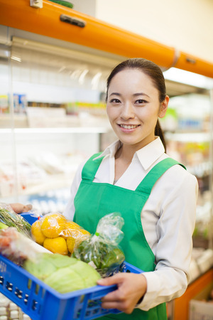 shopping buddies: The saleswoman with a box of vegetables