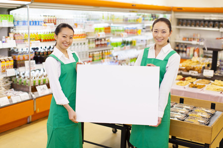 everyday jobs: Clerk of super with a white board Stock Photo