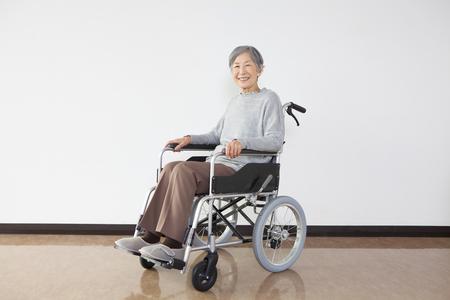 Wheelchair senior woman portrait