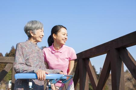 caretaker: Grandma talks to women caregivers