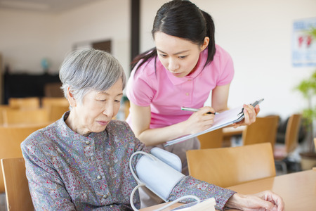health care facility: Grandma measure blood pressure